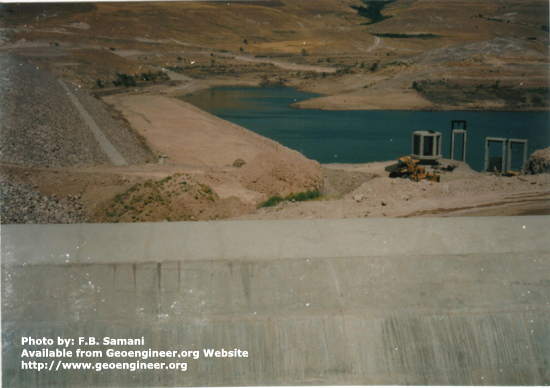 Title: Alaviyan Earthfill Dam, 80m high.<br>Title: Alaviyan Earthfill Dam, 80m high. The photo shows Inlet structures, u/s slope of the dam and concrete wall of Side Channel Spillway.  Donated by: F.B. Samani Date: 1995.