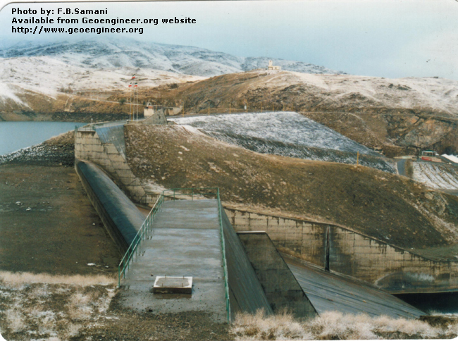 Title: The dam and the spillway, view from right to left<br>Title: Photo No.1: The dam and the spillway, view from right to left. Donated by: F.B. Samani Date: February 1997