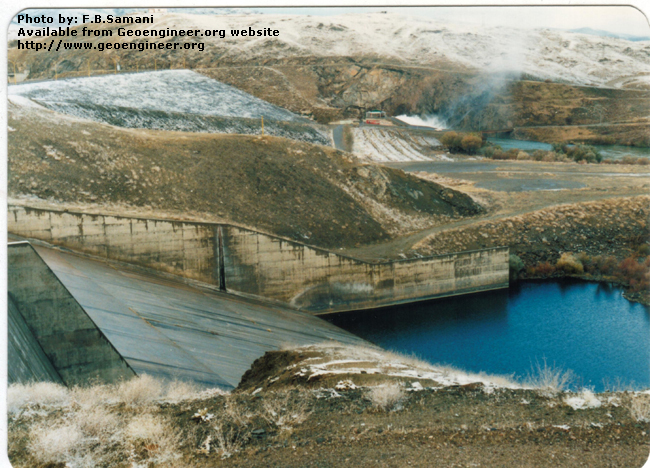 Title: downstream face of the dam<br>Title: Photo No.4: downstream face of the dam. The spillway chute and stilling basin. Donated by: F.B. Samani Date: February 1997