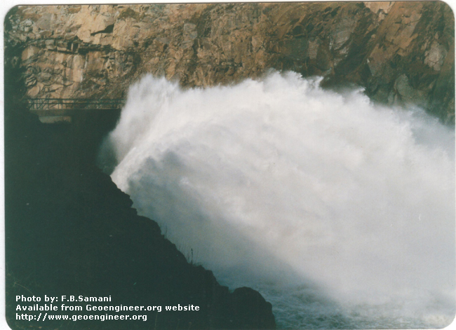 Title: water jetting out of irrigation tunnel<br>Title: Photo No.5: water jetting out of irrigation tunnel. Donated by: F.B. Samani Date: February 1997