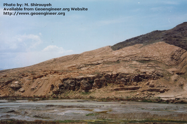 Title: Settlement of karstic limestone<br>Title: Settlement of karstic limestone forming the left reservoir rim.