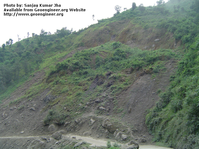 Title: Landslide in Nepal<br>Title: Landslide in Nepal, a rural road blocked due to landslide.