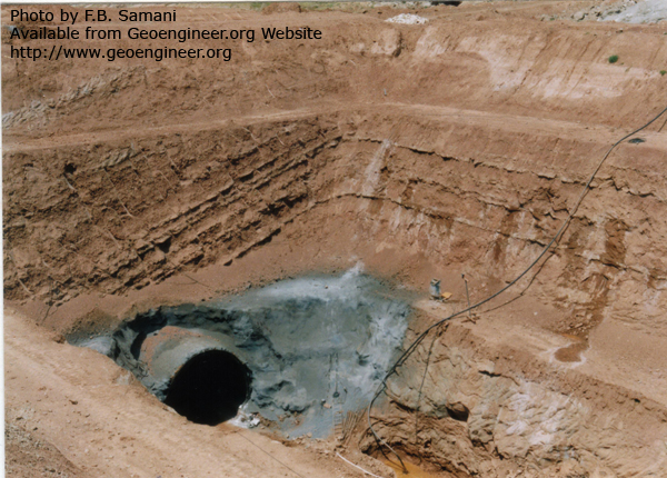 Title: Outlet portal of Dasht-e- Abbas pressure irrigation tunnel<br>Title: Outlet portal of Dasht-e- Abbas pressure irrigation tunnel located near Andimeshk town, Iran. Diameter of 5.5m; length of 6.1km, Excavated in interlayered Miocene mudrock and sandstone. Photo also shows apparent and true dip angle of the layers, in the excavated planes, parallel and perpendicular to the bedding.   Donated by: F.B. Samani Date: september 1995