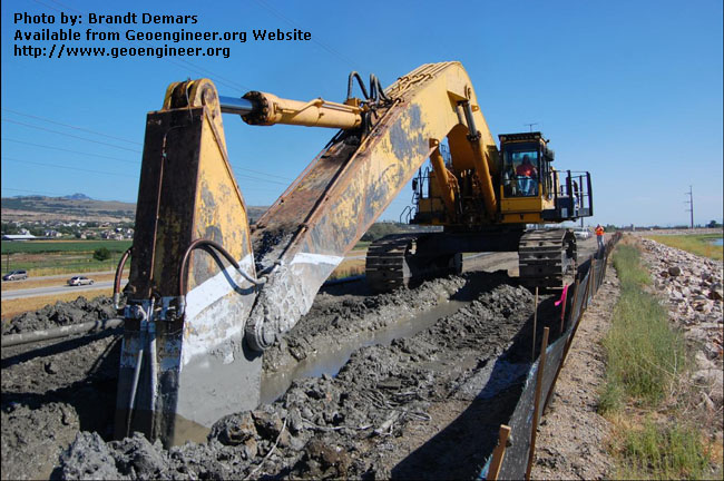 Title: The PC1250 excavator cleans the bottom of the CB trench<br>Title: D-526-418-5134 a?? The PC1250 excavator cleans the bottom of the CB trench near Station 728+60. The final depth of the wall at this location is approximately 54 feet.  Donated by: Jeffrey A. Farrar Date: July 24, 2008