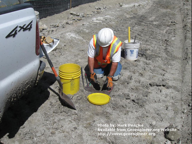 Title: Sand cone in-place density test<br>Title: D-526-418-5414 a?? Reclamation materials technician Tom Haws performs a sand cone in-place density test on the CB wall cap near Station 732+00.  Donated by: Jeffrey A. Farrar Date: August 26, 2008