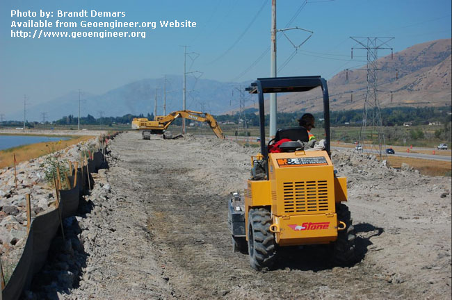 Title: View of CB wall cap backfill<br>Title: D-526-418-5417 a?? View of CB wall cap backfill and compaction operations and slope rehabilitation operations (background) near Station 729+00.  Donated by: Jeffrey A. Farrar Date: August 28, 2008