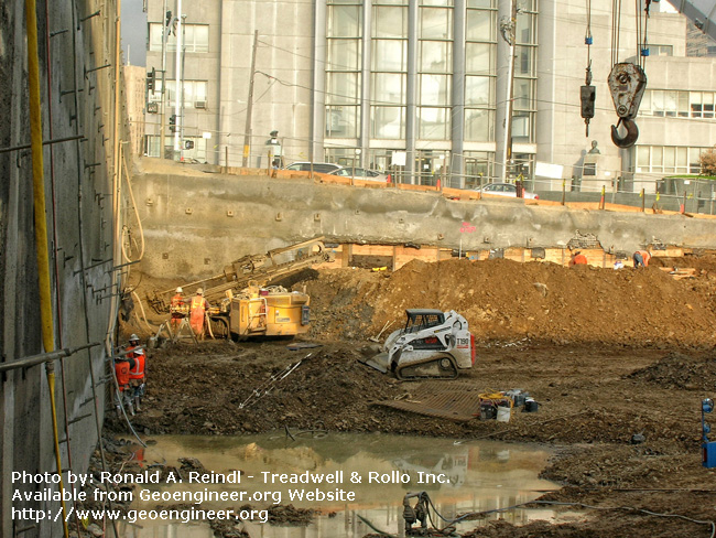 Title: Rincon Hill Soil Nail Wall<br>Title: Rincon Hill Soil Nail Wall, San Francisco, CA. The soil nail/shotcrete wall and the installation of soil nails with a Klemm rig.