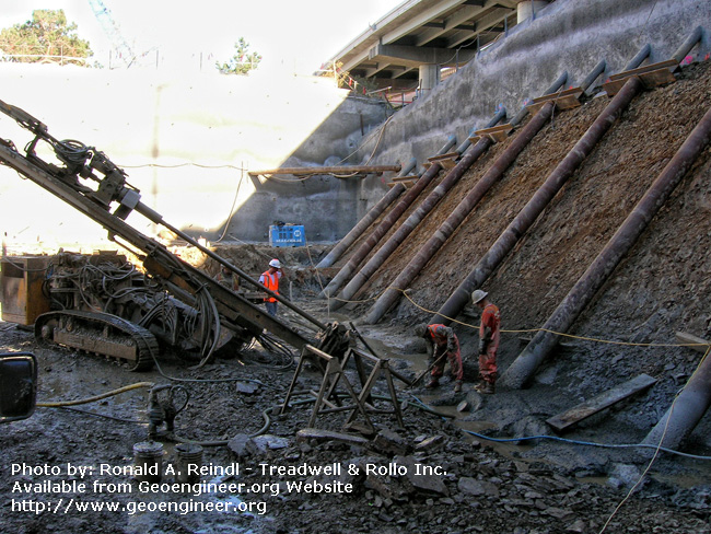 Title: Rincon Hill Tiedown Installation<br>Title: Rincon Hill Tiedown Installation, San Francisco, CA. Tiedowns are being installed at the bottom of the rakers, where a a??footinga?? will later be constructed.