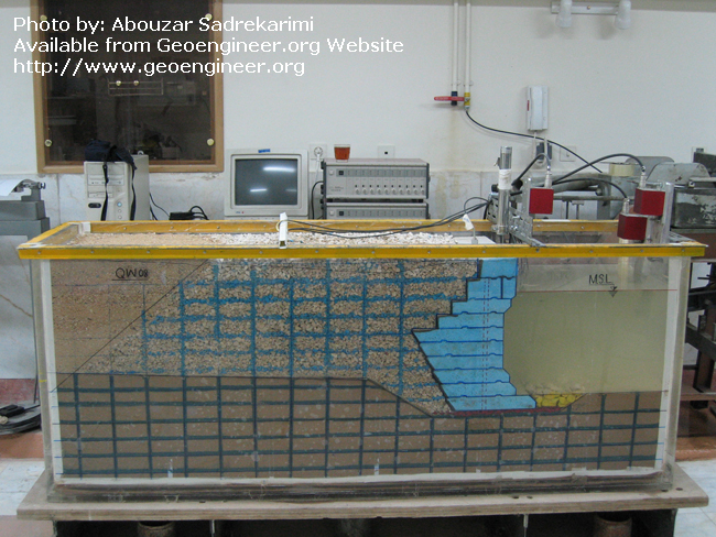 Title: 1g shaking table model test<br>Title: 1g shaking table model test on broken-back retaining wall performed at the University of Tehran, Iran, by Abouzar Sadrekarimi. Additional data can be found in: Sadrekarimi, A., Ghalandarzadeh, A., and Sadrekarimi, J. (2008). a??Static and Dynamic Behavior of Hunchbacked Gravity Quay Wallsa?? Journal of Soil Dynamics and Earthquake Engineering, Vol. 28, No.2. 