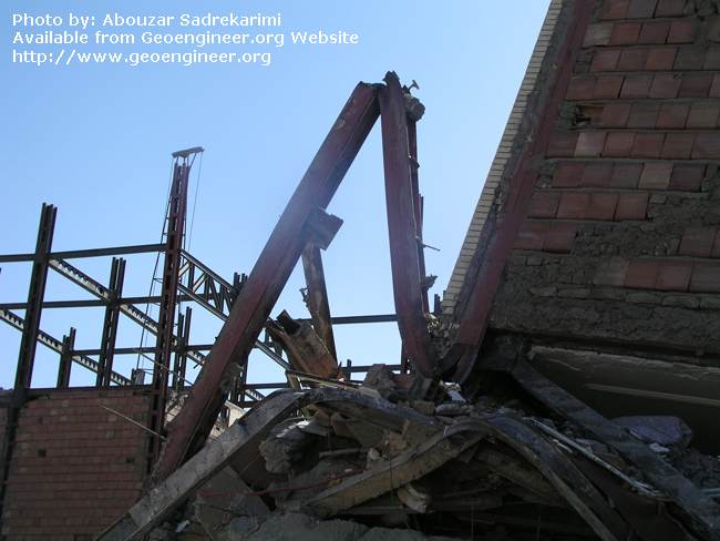 Title: Severely deformed (bent) steel column<br>Title: Severely deformed (bent) steel column, Bam City, Iran.