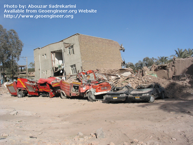 Title: Sandwiched firefighting vehicles<br>Title: Sandwiched firefighting vehicles, Bam City, Iran.