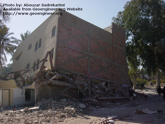 Title: Soft Storey building failure<br>Title: Soft Storey building failure. Larger flexibility of first storey resulted in excessive deflections which in turn lead to concentration of forces at the second storey connections accompanied by large plastic deformations. Note the plastic hinges formed at the ends of the columns. Bam City, Iran.