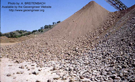 Title: Segregated Earthfill at Top and Rockfill at Bottom of Stockpile Slope.<br>Title: Segregated Earthfill at Top and Rockfill at Bottom of Stockpile Slope.