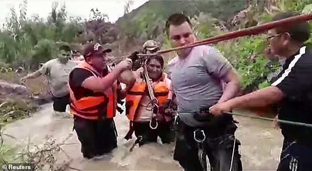 Rescue operation for a man that was swept up by flood waters in Peru